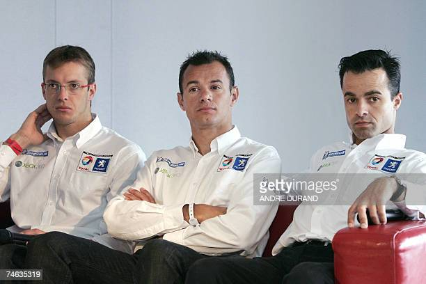 French Peugot drivers Sebastien Bourdais Stephane Sarrazin and Portugese Pedro Lamy who got the pole position give a press conference 15 June 2007 in...