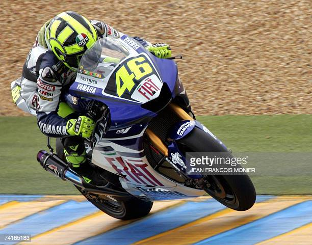 Italian MotoGP rider Valentino Rossi rounds a corner on his Yamaha during the second free practice session of the Grand Prix of France 18 May 2007 on...