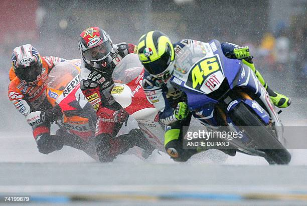 Italian MotoGP rider Valentino Rossi rounds a corner ahead of German Alex Hoffman and Spanish Dani Pedrosa during the French Grand Prix 20 May 2007...