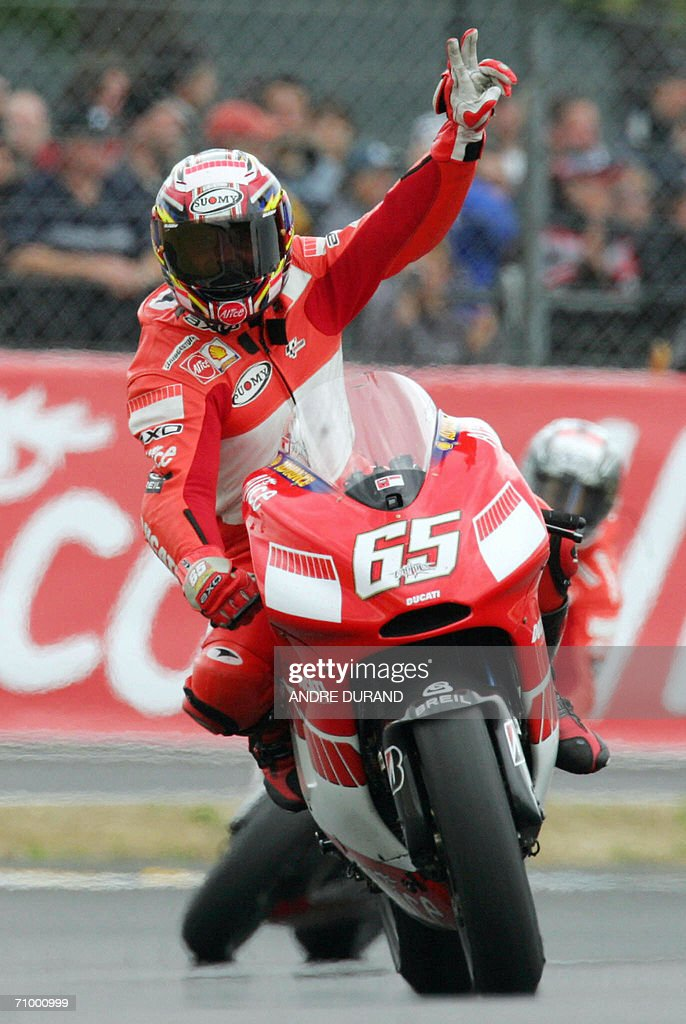 Italy's Honda driver Loris Capirossi celebrates as he crosses the finish line of the French MotoGP Grand Prix, 21 May 2006 at the Le Mans racetrack, western France. Italy's Marco Melandri won the race ahead of his compatriot Loris Capirossi and Spain's Daniel Pedrosa.