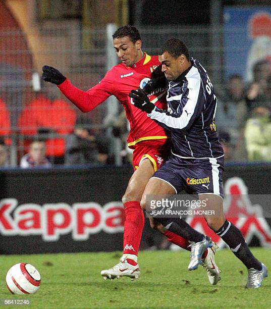 Le Mans' miedfielder James Fanchone fights for the ball with Bordeaux' midfielder Denilson De Olivera during their French L1 football match 10...