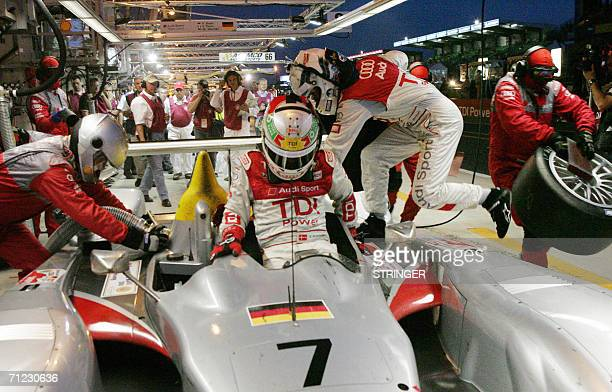 Mechanics change the tires and refuel the Audi R10 Diesel number 7 as Danish driver Tom Kristensen is replaced for a relay by his teammate British...