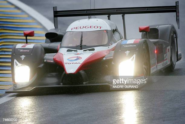 The Peugeot 908 HDiFAP of French driver Nicolas Minassian Spain's Marc Gene and Canada's Jacques Villeneuve takes a curve during a practice at Le...