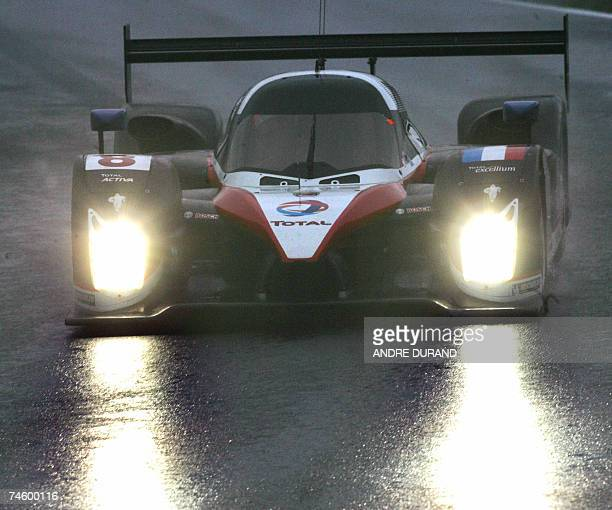 The Peugeot 908 HDiFAP of French drivers Stephane Sarrazin Sebastien Bourdais and Portugal's Pedro Lamy speeds during a practice at Le Mans 24hour...