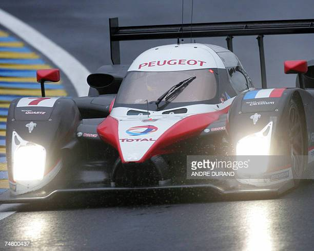 The Peugeot HDIFAP of French driver Nicolas Minassian Spanish Marc Gene and Canadian Jacques Villeneuve takes a curve during a practice at Le Mans...