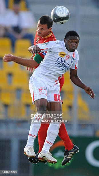 Le Mans� French defender Gregory Cerdan fights for the ball with Nancy�s Cameroonian midfielder Paul Alo'o Efoulou during their French L1 Football...