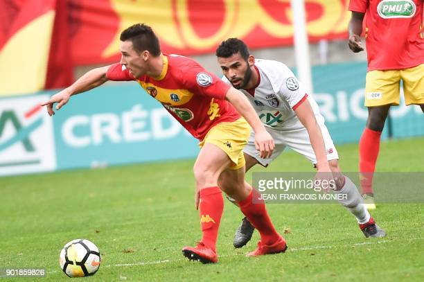 Le Mans' French forward Vincent Crehin vies with Lille's Cameroon defender Ibrahim Amadou during the French Cup final football match between Le Mans...