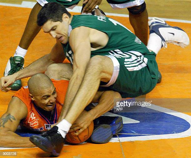Le Mans' Rahshon Turner vies with ASVEL's David Frigout during their French ProA basketball match 22 February 2004 in Le Mans AFP PHOTO JEANFRANCOIS...