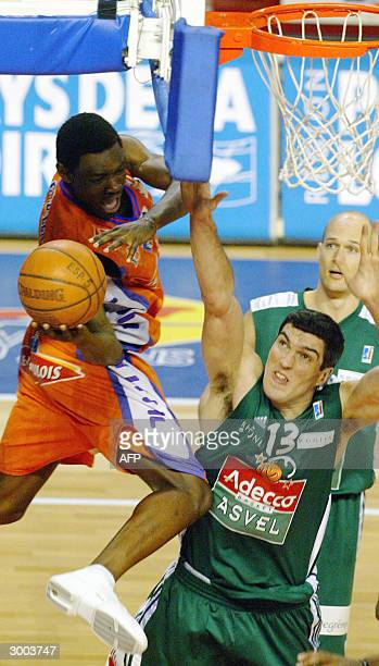Le Mans' Yannick Bokolo vies with ASVEL's David Frigout during their French ProA basketball match 22 February 2004 in Le Mans AFP PHOTO JEANFRANCOIS...