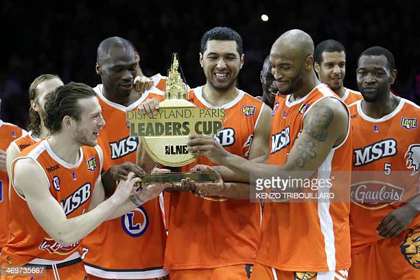 Le Mans's players pose with their trophy as they celebrate after winning the Leaders Cup/ LNB 2014 basketball tournament final match on February 16...