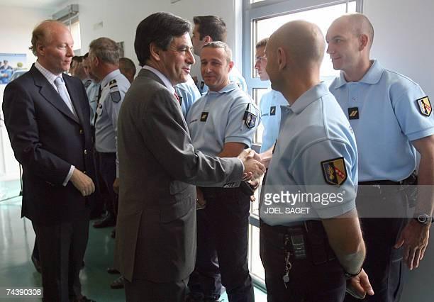 Le Mesnil-Amelot, FRANCE: Le Premier ministre Francois Fillon , accompagne du ministre de l'Immigration, de l'Integration, de l'Identite nationale et...