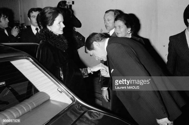 Le ministre René Haby fait un baisemain à AnneAymone Giscard d'Estaing lors d'une soirée avec à droite Simone Veil le 1er février 1977 à Paris France