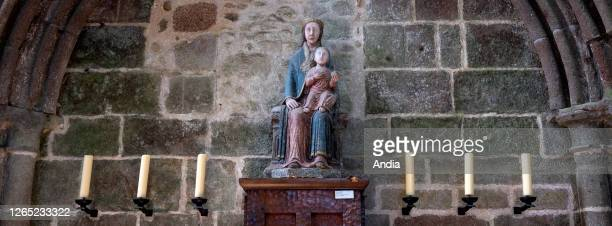 Le Mont Saint-Michel : statue of the Madonna and the Child in the abbey dating back to the XIIth century .
