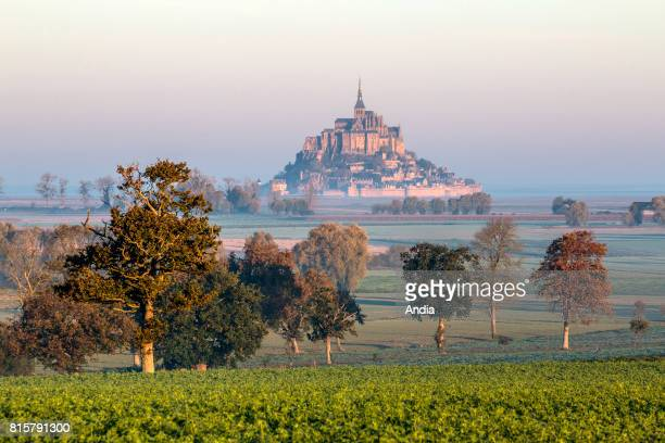 Le Mont-Saint-Michel . . Autumnal scenery with mist in the early morning.