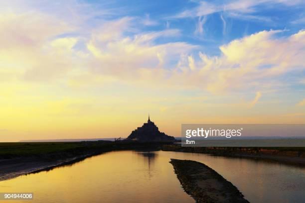 Le Mont-Saint-Michel in a colorful sunset (France, Normandy)