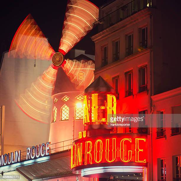 le moulin rouge cabaret in the night on paris - infrared lamp stock photos and pictures