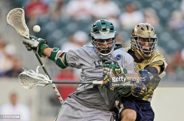 Le Moyne mid-fielder Brain Griffin loses the ball as Dowling mid-fielder Frank Brunetti checks him in the Division II Lacrosse Finals Sunday, May 28,...