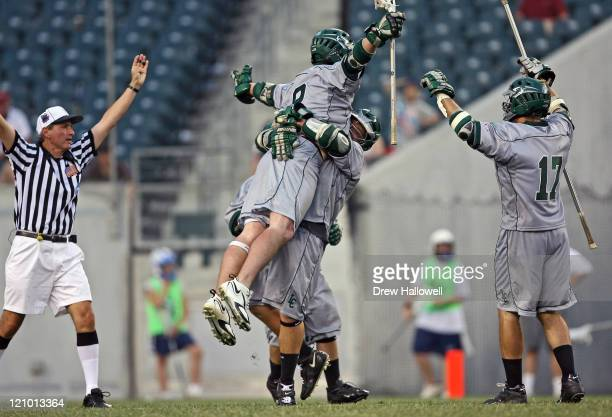 Le Moyne mid-fielder Brian Griffin celebrates with his teammates after scoring a goal in the Division II Lacrosse Finals Sunday, May 28, 2006 at...