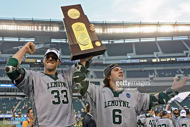 Le Moyne mid-fielder Craig Rosecrans and attacker Jason Longo hold the championship trophy in the Division II Lacrosse Finals Sunday, May 28, 2006 at...