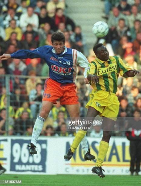 le nantais Japhet N'Doram est aux prises avec le montpelliérain Laurey le 17 mai à Nantes lors du match Nantes/Montpellier comptant pour championnat...