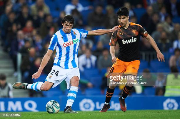 Le Normand of Real Sociedad duels for the ball with Carlos Soler of Valencia CF during the Liga match between Real Sociedad and Valencia CF at...