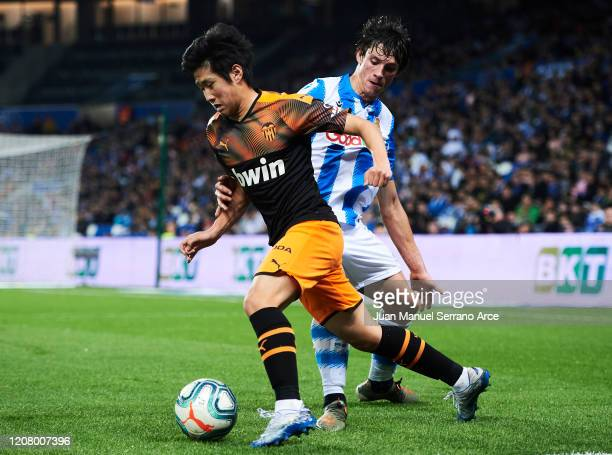 Le Normand of Real Sociedad duels for the ball with Lee KangIn of Valencia CF during the Liga match between Real Sociedad and Valencia CF at Estadio...