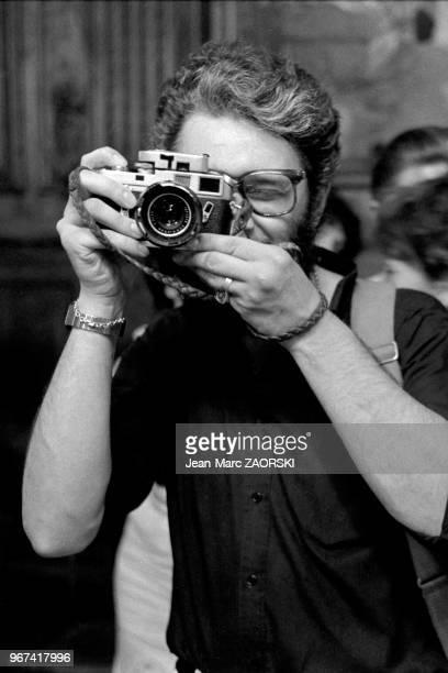 Le photographe français PierreJean Amar lors des rencontres internationales de la photographie d'Arles en France le 13 juillet 1982
