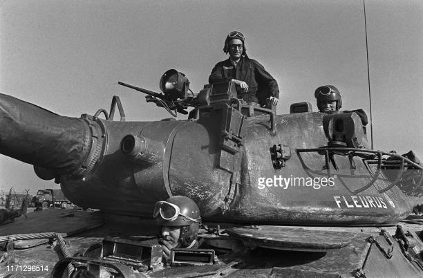 Prime Minister of President Giscard d'Estaing Jacques Chirac inspects on February 20 1975 at the Mailly military camp an AMX 30 tank during the...