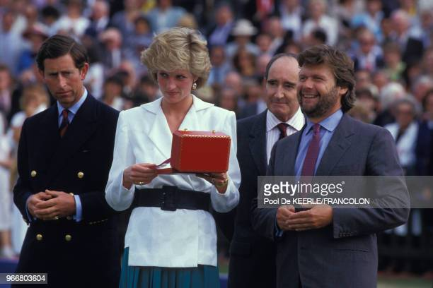 Le Prince Charles et Diana lors du trophée de Polo Cartier le 27 juillet 1986 à Windsor RoyaumeUni