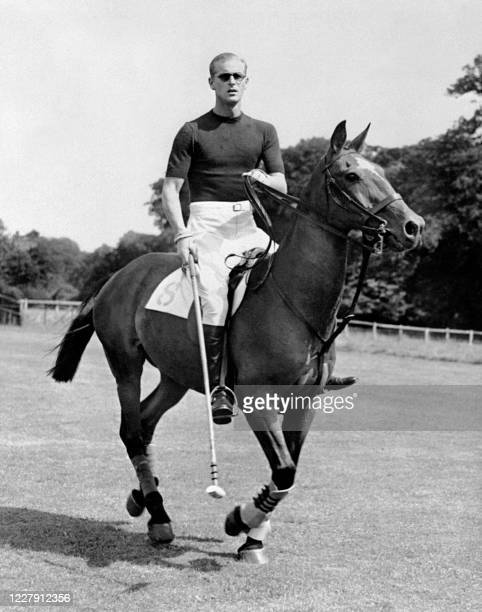 Prince Philip of Edinburgh, on leave in England, played polo on August 7 a few days before the birth of his second child.