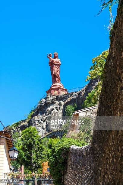 statue of NotreDame de France on top of the Corneille rock overhanging the roofs of the city Sculpted by JeanMarie Bonnassieux in 1860 the sculpture...