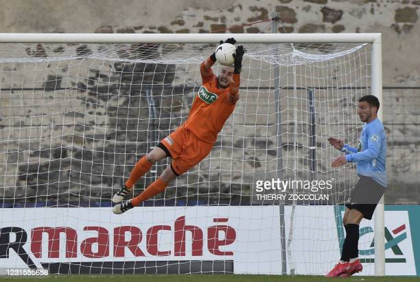 Le Puy's goalkeeper David Oberhausser makes a save during the French Cup football match between Le Puy-en-Velay and Lorient at Charles-Massot stadium...