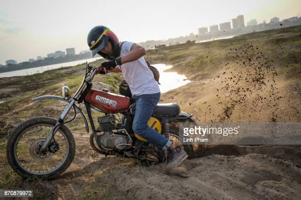 Le Viet Bach 26 a Minsk motorcycle enthusiast pratices new tricks on the dirt tracks in preparation for an offroad tournament on the following day on...