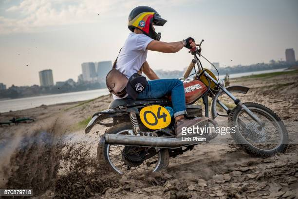 Le Viet Bach 26 a Minsk motorcycle enthusiast pratices on the dirt track in preparation for an offroad tournament on the following day on November 4...