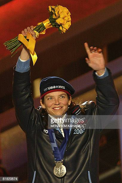 Lea Ann Parsley of the USA celebrates her silver medal in the Women's Skeleton at the XIX Winter Olympics 20 February 2002 in Salt Lake City Utah AFP...