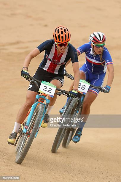 Lea Davison of United States and Pauline Ferrand Prevot of France race during the Women's CrossCountry Mountain Bike Race on Day 15 of the Rio 2016...