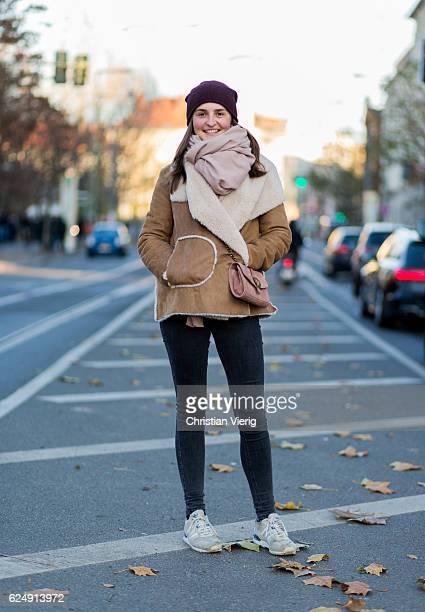 Lea Frank wearing a beige sheepskin jacket bordeaux wool hat grey denim pants pink Zara bag and scarf and sneaker on November 21 2016 in Berlin...