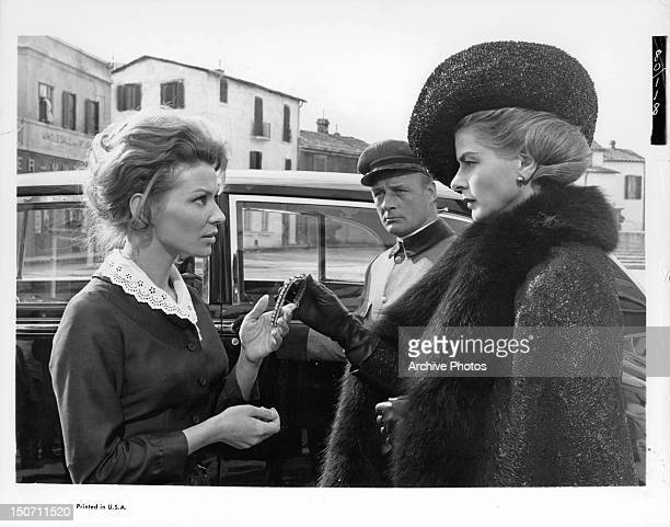 Lea Massari is given piece of jewelry by Ingrid Bergman in a scene from the film 'The Visit', 1964.