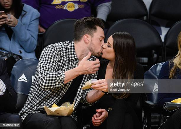 Lea Michele and Matthew Paetz kiss at a basketball game between the Golden State Warriors and the Los Angeles Lakers at Staples Center on January 5...