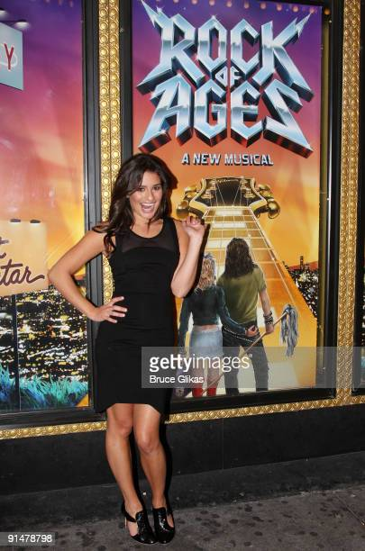 Lea Michele poses as she attends the hit rock musical 'Rock of Ages' on Broadway at The Brooks Atkinson Theater on October 6 2009 in New York New York