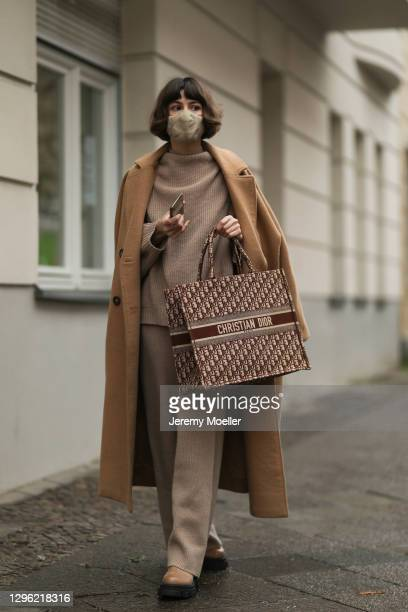 Lea Naumann wearing Dior bag, Zalando coat and shoes and Wolford clothings on January 12, 2021 in Berlin, Germany.