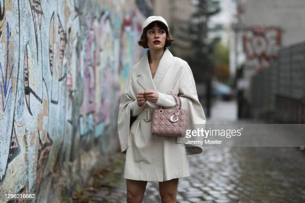 Lea Naumann wearing Nobi Talai coat, Dior bag and can't decide clothing cap on January 12, 2021 in Berlin, Germany.