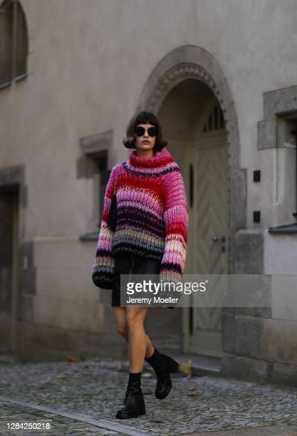 Lea Naumann wearing Prada bag, Blanche sweater, Chanel shades, Zalando skirt and Vagabond boots on November 05, 2020 in Berlin, Germany.