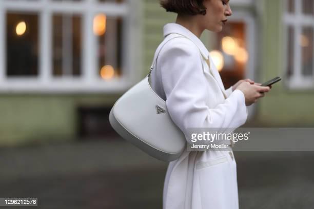 Lea Naumann wearing Prada Cleo bag, Nobi Talai beige coat on January 12, 2021 in Berlin, Germany.