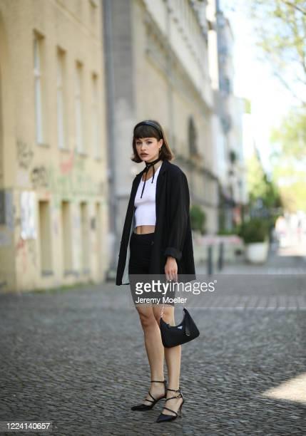 Lea Neumann wearing Aldo heels, Prada bag and complete H&M look on May 06, 2020 in Berlin, Germany.