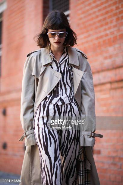 Lea Neumann wearing Burberry trenchcoat and weekday pants and shirt on May 06, 2020 in Berlin, Germany.