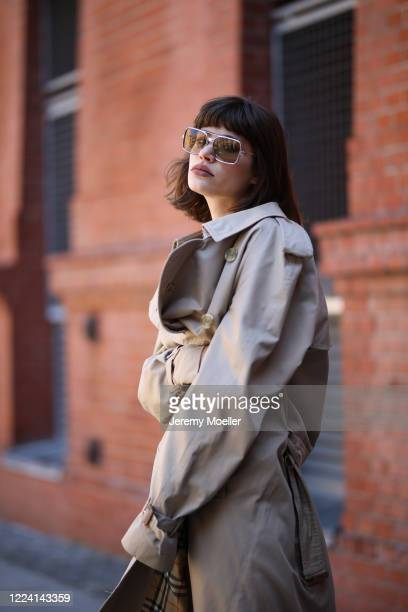 Lea Neumann wearing Burberry trenchcoat, Balenciaga Triple S and weekday pants and shirt on May 06, 2020 in Berlin, Germany.