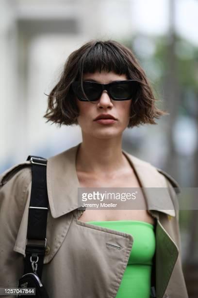 Lea Neumann wearing Burberry vintage coat, Prada bag, Bershka two piece, Weekday shades on July 15, 2020 in Berlin, Germany.