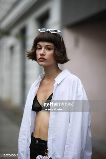 Lea Neumann wearing Fendi California Sky bag, Zara pants, Otiumberg earrings and Weekday shirt on July 15, 2020 in Berlin, Germany.