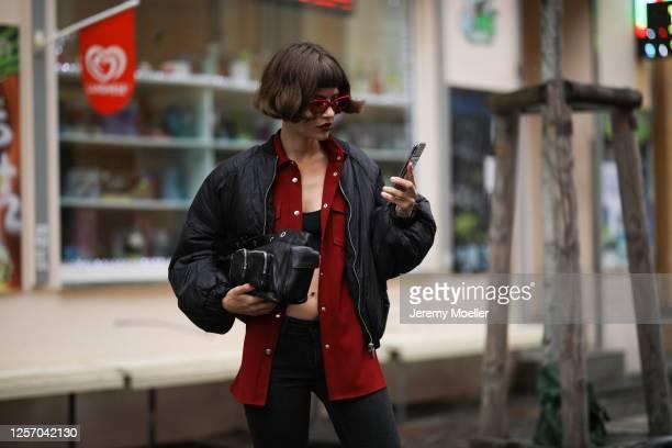 Lea Neumann wearing GStar Jeans, Otto d'ame jacket, Valentino shades, Zara Bomberjacket and Jil Sander bag on July 15, 2020 in Berlin, Germany.